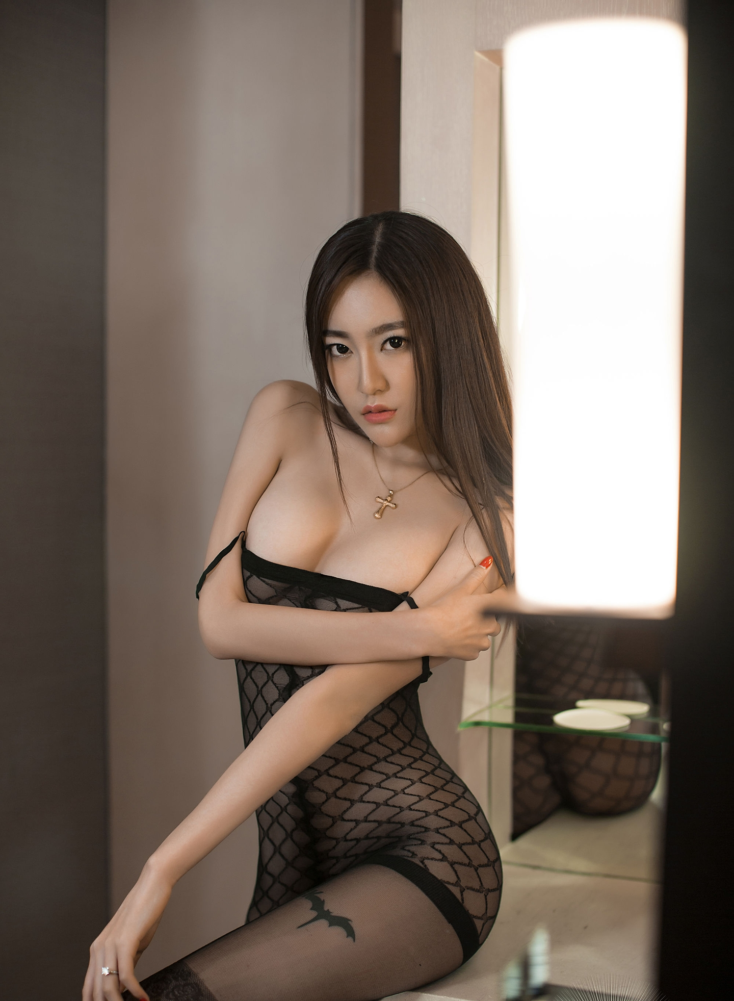 hot Asian woman in mesh lingerie
